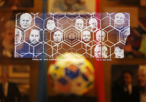 """A video on FIFA corruption is reflected in a display at the Mob Museum Tuesday, Sept. 1, 2015, in Las Vegas. The display, titled """"The 'Beautiful Game' Turns Ugly"""", opens at the museum Tuesday. (AP Photo/John Locher)"""