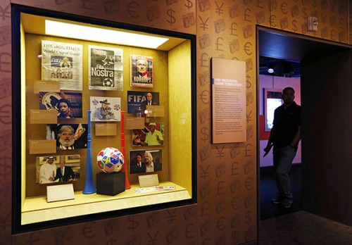 """Items on FIFA corruption are on display at the Mob Museum Tuesday, Sept. 1, 2015, in Las Vegas. The display, titled """"The 'Beautiful Game' Turns Ugly"""", opens at the museum Tuesday. (AP Photo/John Locher)"""
