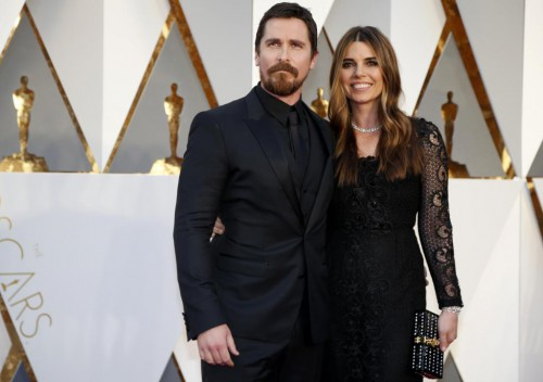 "Christian Bale, nominated for Best Supporting Actor for his role in ""The Big Short,"" arrives with wife Sibi Blazic. REUTERS/Lucy Nicholson"